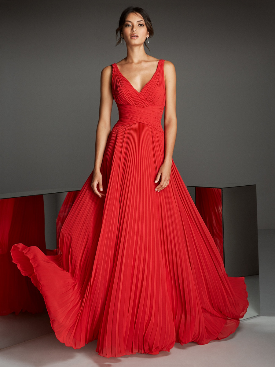 f15a38f9ad19 Sheath dress in red chiffon with cross over draping at waste and pleated  skirt