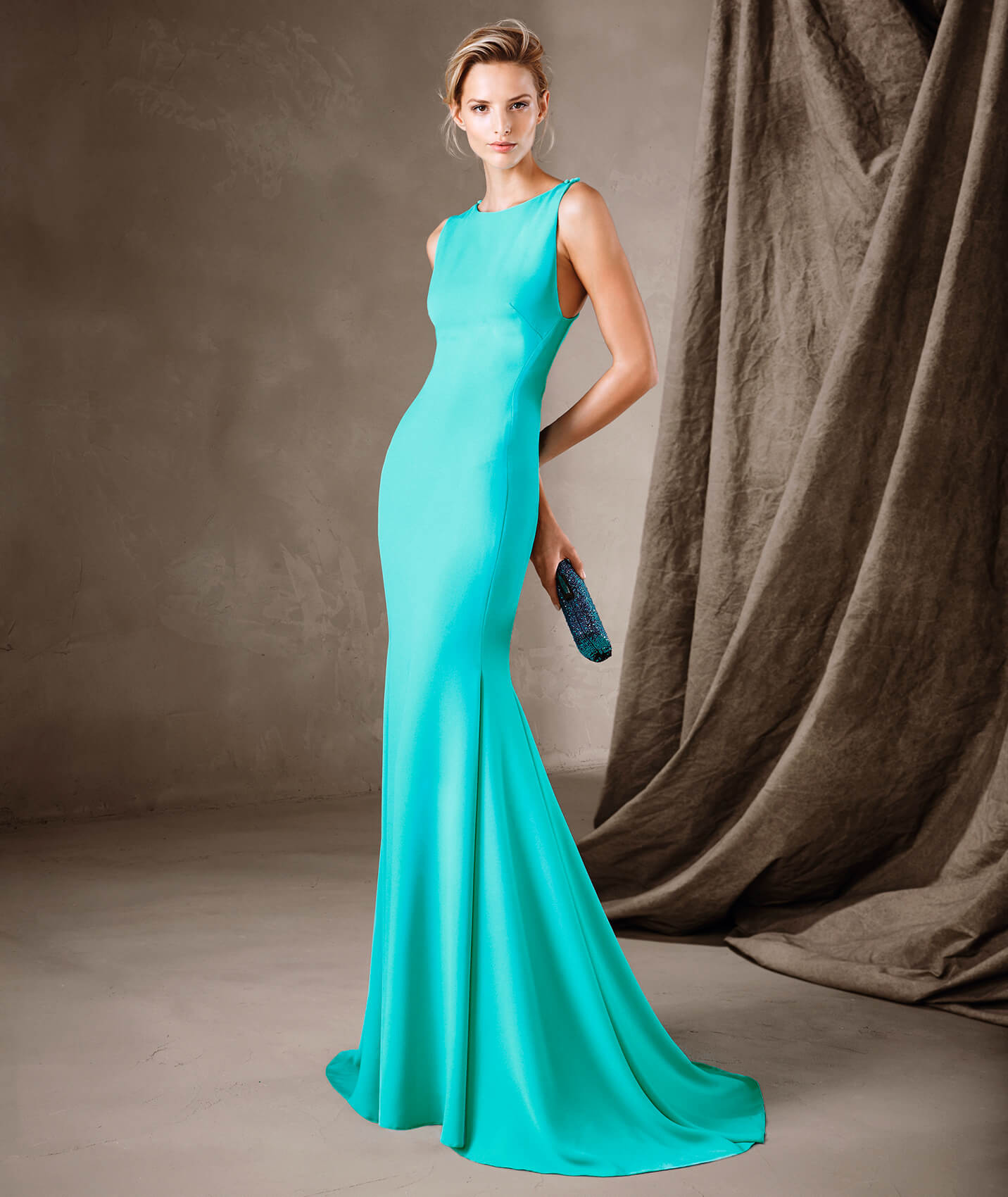 Seductive long crepe gown with a sleeveless mermaid silhouette and ...